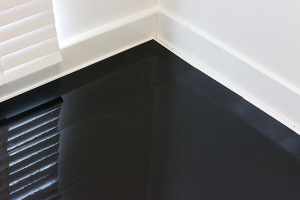 An image of our Designer Black high-gloss laminate flooring.
