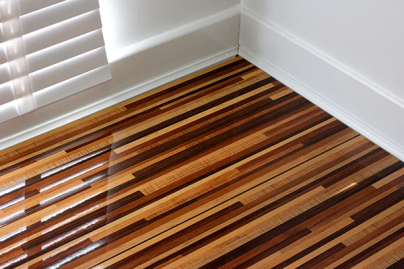 Designer Wood-Style Strips – High-Gloss Laminate Flooring