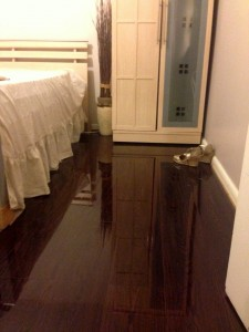 This bedroom has just experienced the 'Wow' factor of Floorless Floors high gloss laminate