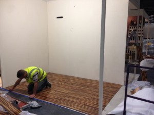 Construction manager Neil Smith adding the finishing touches to the floor.