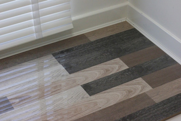 An image of our Grey and Brown Slates design high gloss laminate flooring.