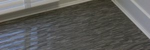 An image of our Grey Wood-Style Striped high-gloss laminate flooring.