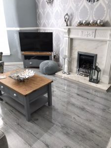 Coffee table and chair staged on high-gloss grey wood flooring at different angle