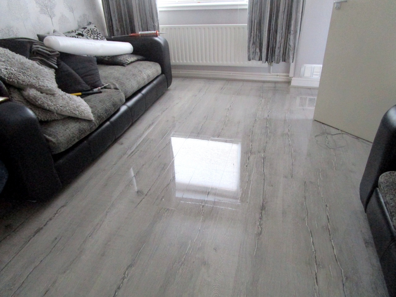 Natural light from window reflected on high-gloss of flooring