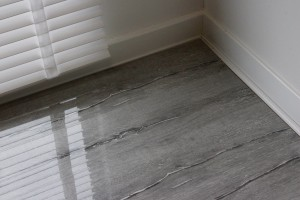 Close up of the variegated greys in each board in the flooring