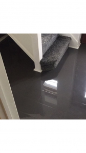 high-gloss solid color laminate flooring in graphite