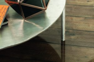 Modern table modeled on the high-gloss laminate flooring